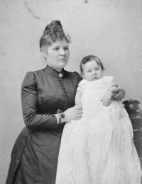 Thora Alfride Holm with her first born circa 1875.jpg